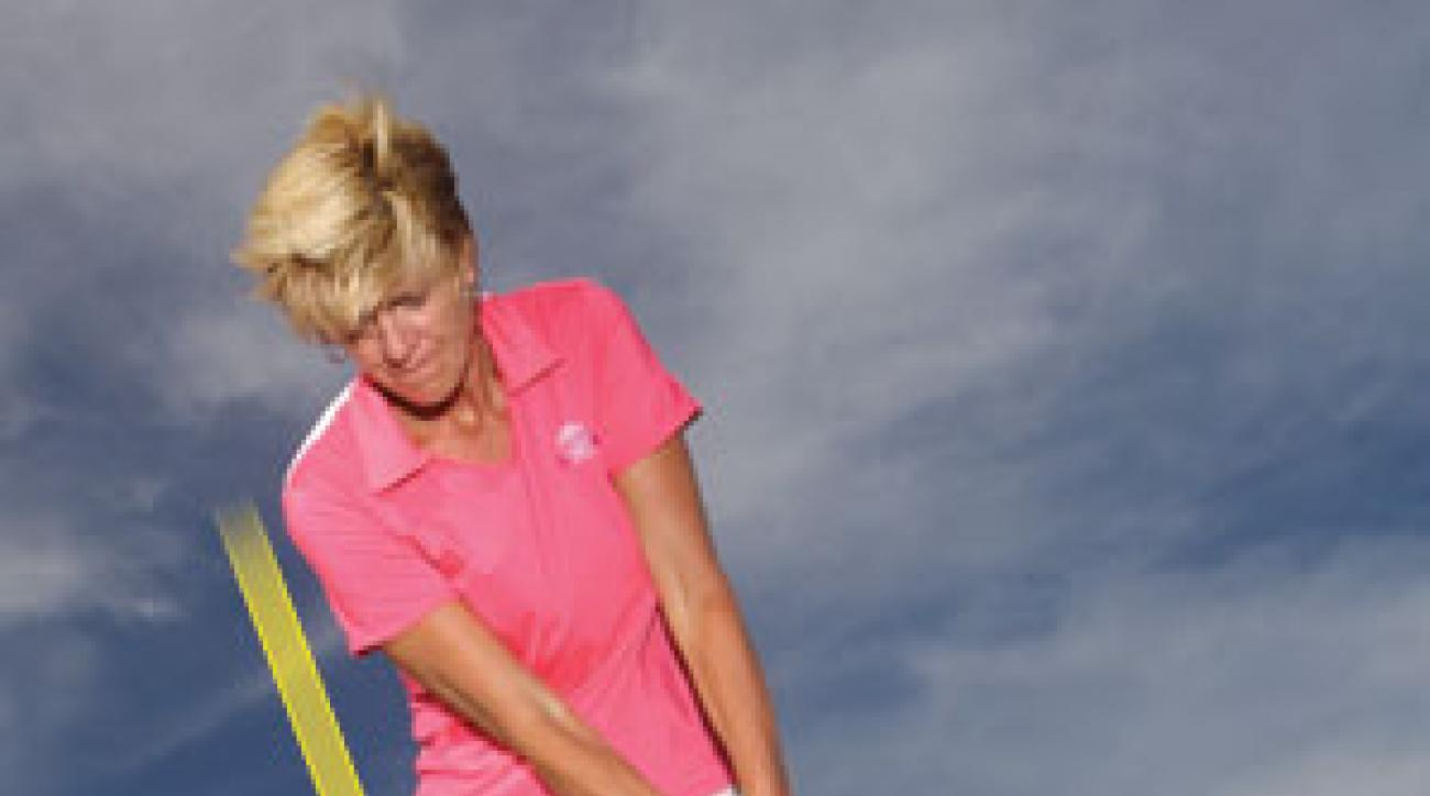 Play the ball forward, lean with the slope and keep your hands ahead of the clubhead.