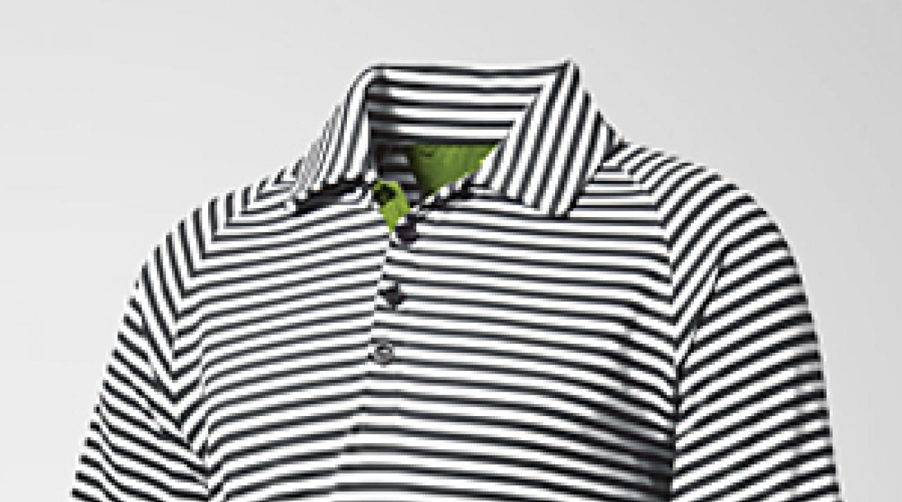 Moisture-wicking golf polo with embroidered Fila logo.