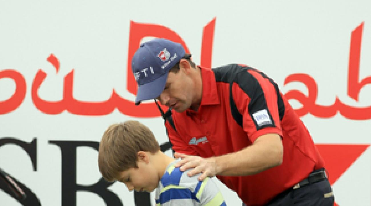Padraig Harrington offered tips to a young fan during a golf clinic Saturday in Abu Dhabi.