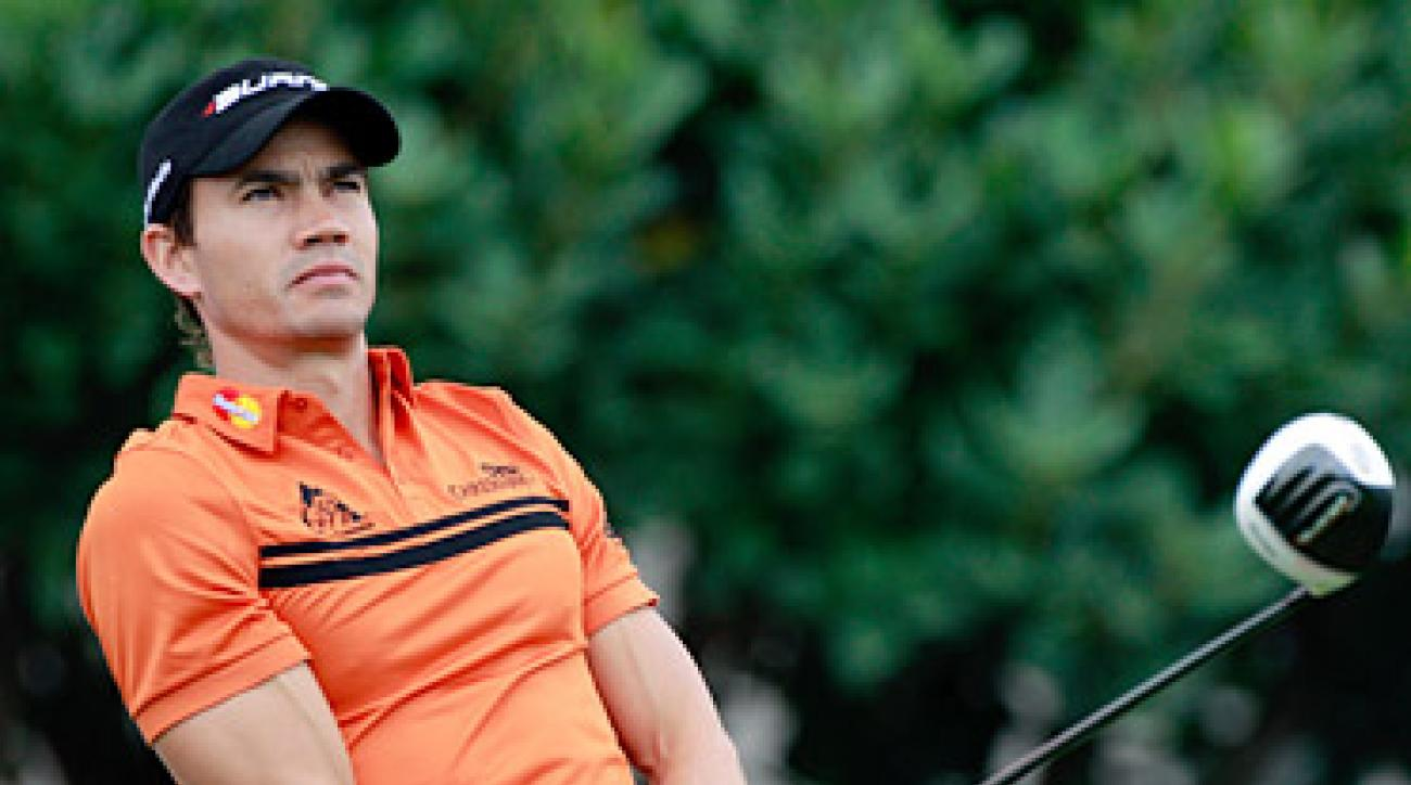 Camilo Villegas shot a 71 in the first round but was disqualified for a rules gaffe on the 15th hole.