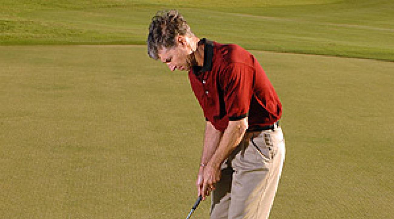 Putting between two clubs will keep you from cutting across the ball.