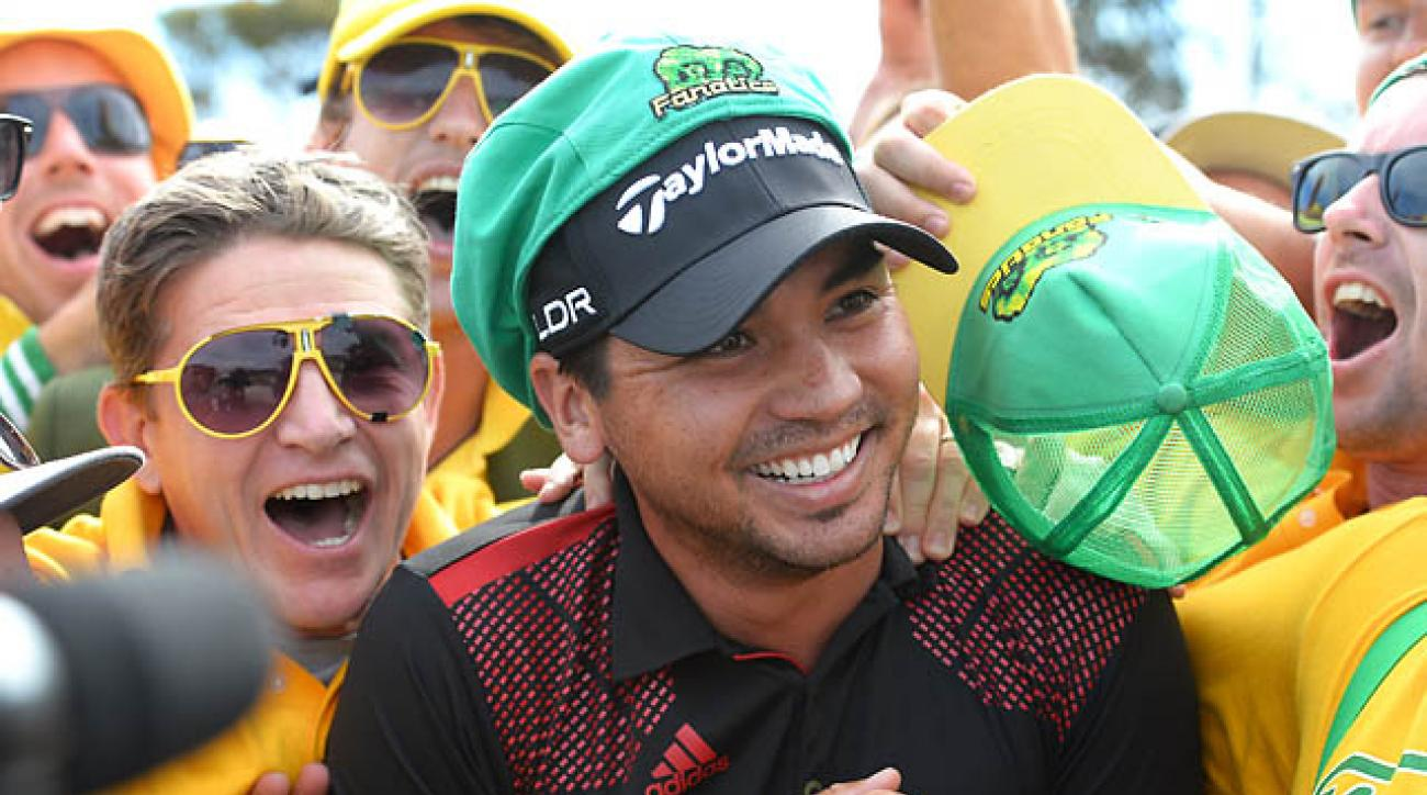 Jason Day is congratulated by fans after winning the individual and team event of the Golf World Cup tournament played at the Royal Melbourne course in Melbourne.
