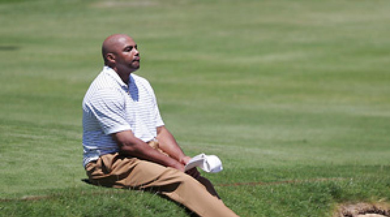 Charles Barkley sits by the water after hitting his ball into the pond on No. 18.