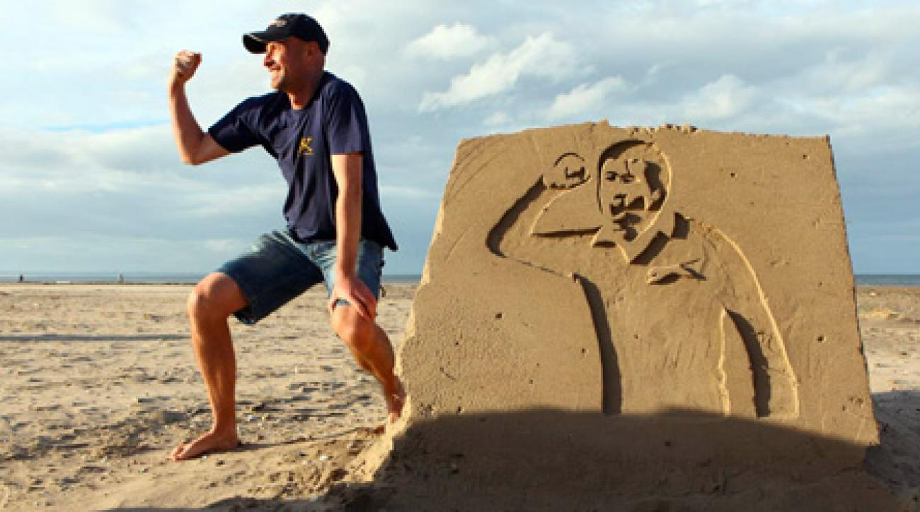 "Doug Clement, founder of Kingsbarns Distillery, with a sand sculpture of Seve Ballesteros. <strong><a href=""http://www.golf.com/golf/gallery/article/0,28242,2004622,00.html"">More Photos</a></strong>"