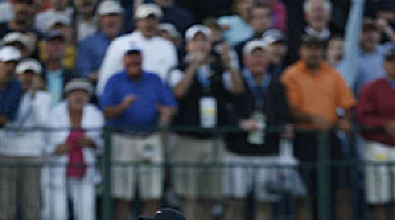 Woods after sinking his eagle putt on No. 18.