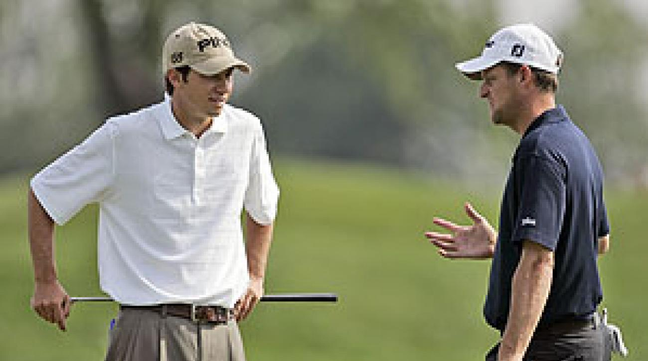 Jeff Golden, left, chats with Peter Hanson during their practice round Wednesday.