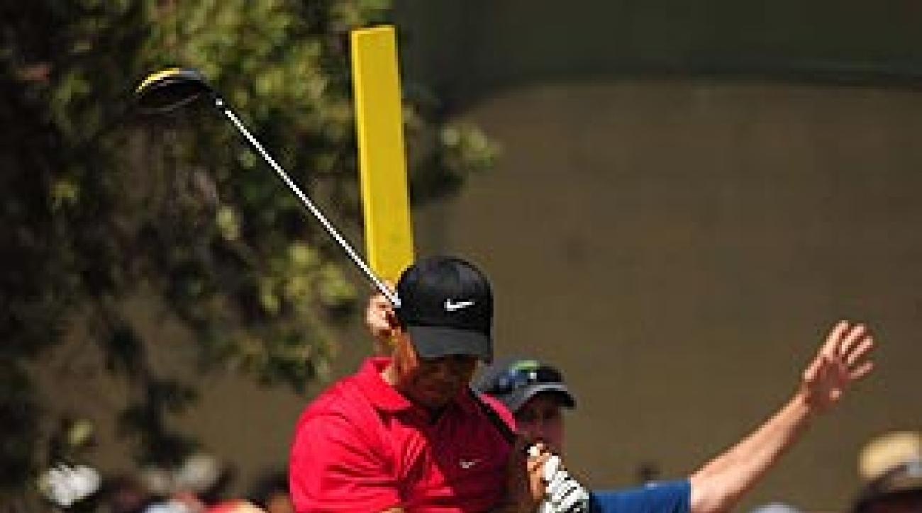 Woods winced often after shots at the U.S. Open.