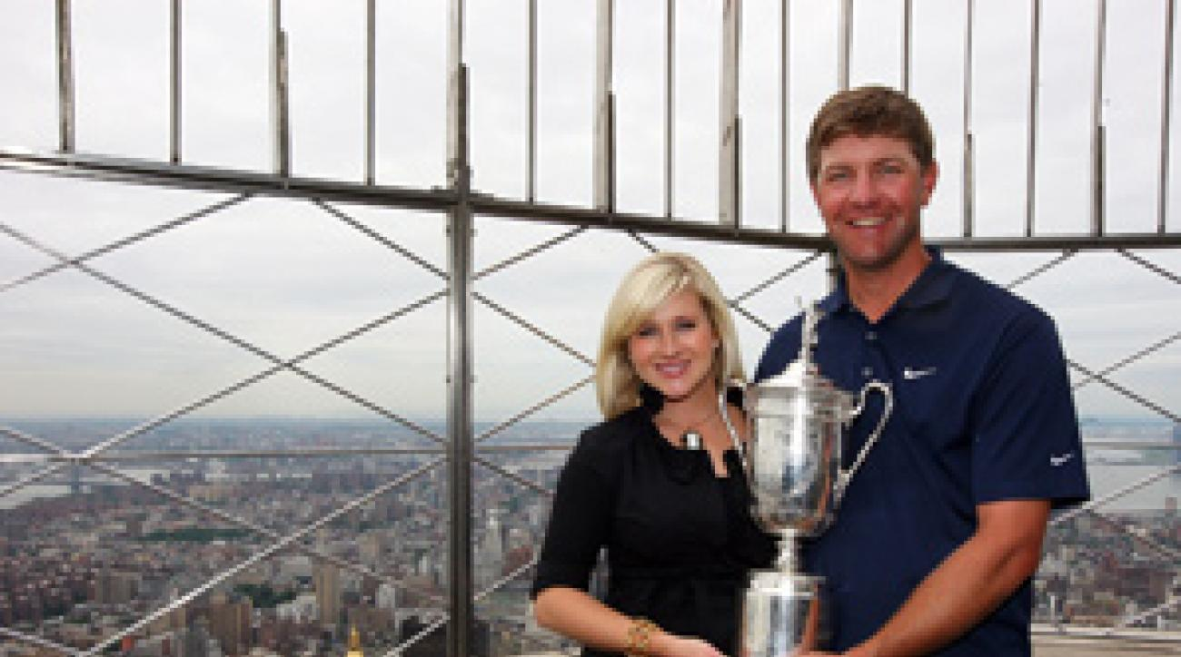 Lucas Glover and his wife, Jennifer, took the U.S. Open trophy to the top of the Empire State Building on Tuesday.
