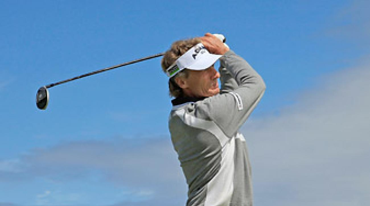 "Bernhard Langer took the lead on day one with a 64. <strong><a href=""http://www.golf.com/photos/2012-senior-british-open-turnberry/senior-british-open-2012-first-round"">More photos</a></strong>"