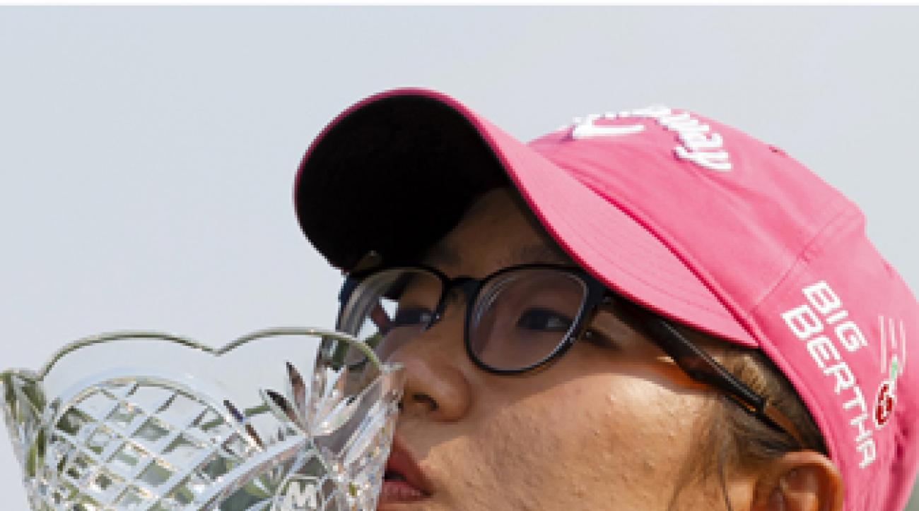 Lydia Ko kisses the trophy after winning the Marathon Classic LPGA golf tournament.