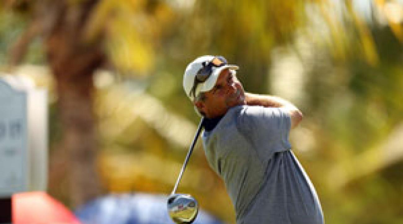 Fred Couples made 11 birdies and a bogey to win by two strokes.