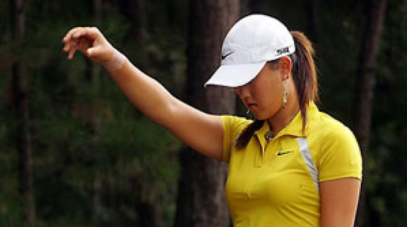 Wie took a drop on the par-3 14th hole. She made a triple bogey.
