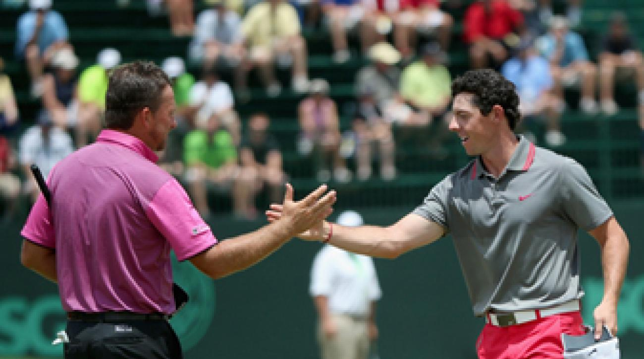 Rory McIlroy and Graeme McDowell shake hands at the 2014 British Open.