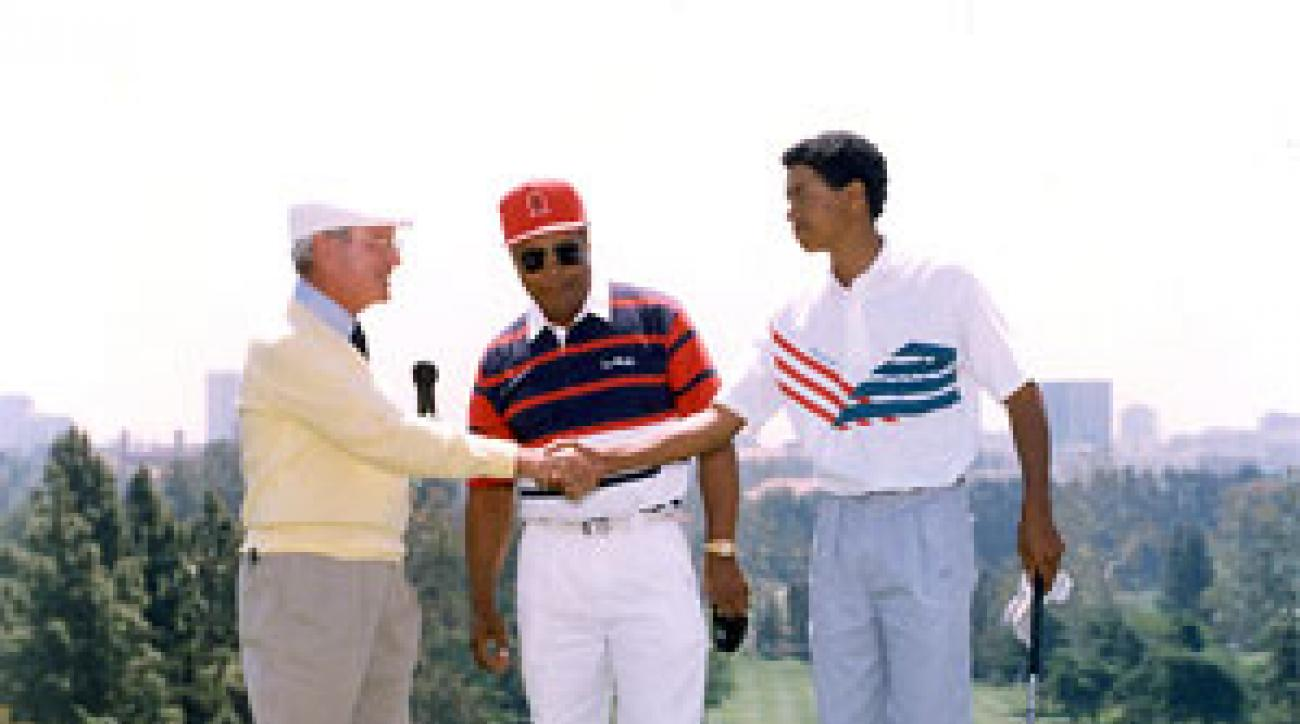 Eddie Merrins, left, invited a then 15-year-old Tiger Woods and his father Earl to a clinic at the Bel-Air Country Club.