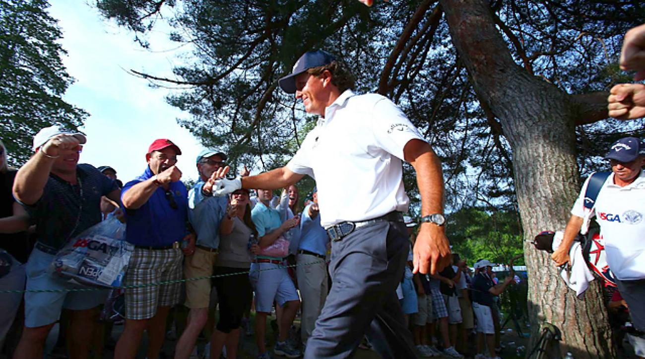 Phil Mickelson heard the roars all afternoon while firing an even-par 70 for a one-shot lead heading into Sunday.