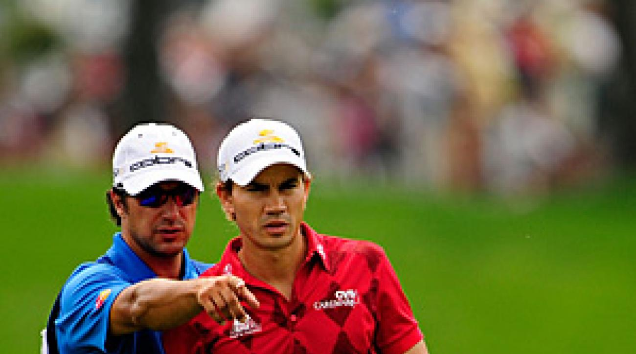 Brett Waldman (left, caddying for Camilo Villegas at the 2010 PGA Championship) has made it to the final stage of PGA Tour Q-school.
