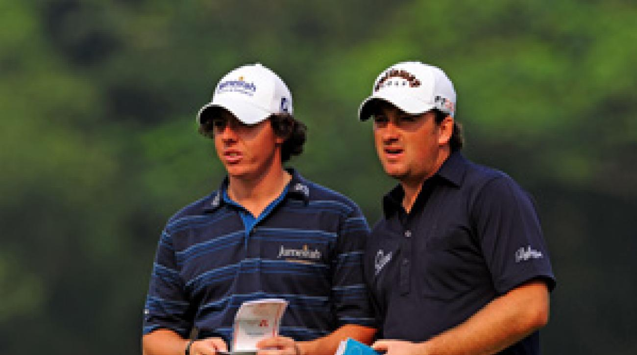 Rory McIlroy and Graeme McDowell of Ireland lead Sweden by two shots.