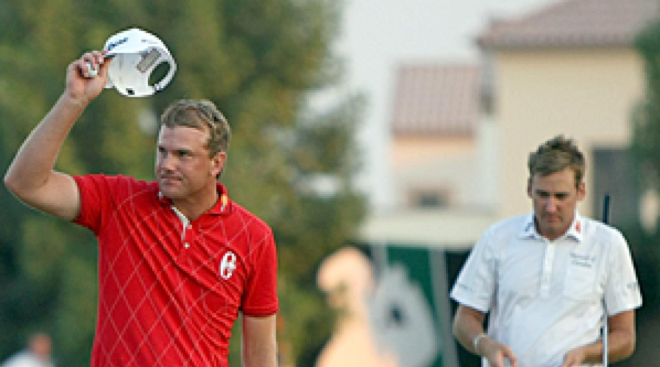 Robert Karlsson, left, beat Ian Poulter in a two-hole playoff.