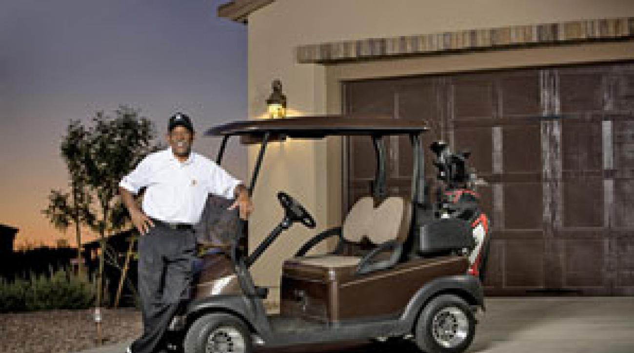 Among the fruits of Walker's retirement: his own golf cart.