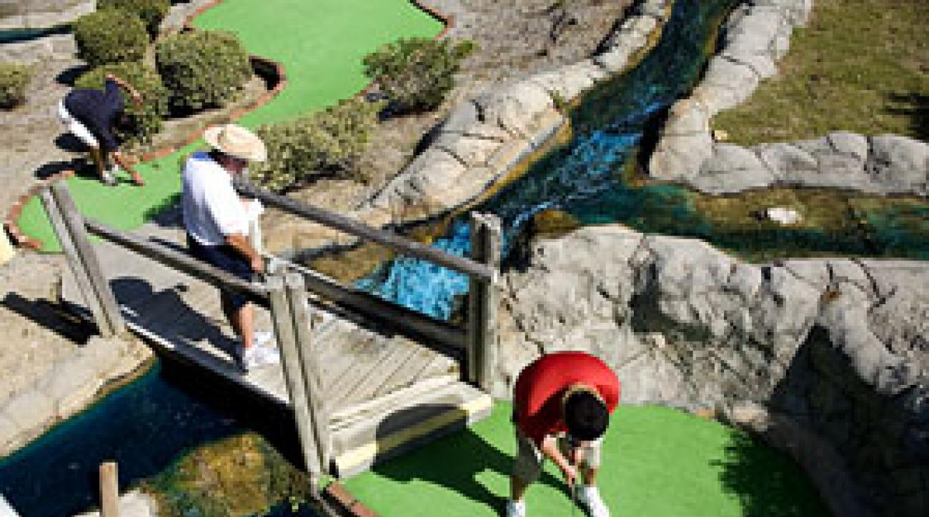 Men at work: Don't tell                 these guys minature golf                 is child's play.