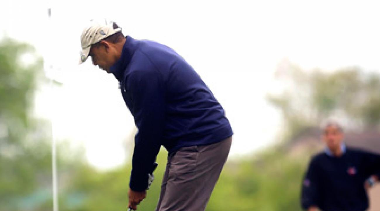 President Barack Obama (shown here playing golf on May 6) teed it up with ESPN commentators Michael Wilbon and Tony Kornheiser on Saturday.