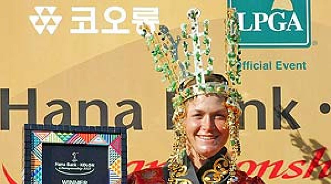 Suzann Pettersen donned traditional Korean garb after making the wind-shortened (to 36 holes) Hana Bank Kolon Championship, in Gyeongju, her fourth win of the season.