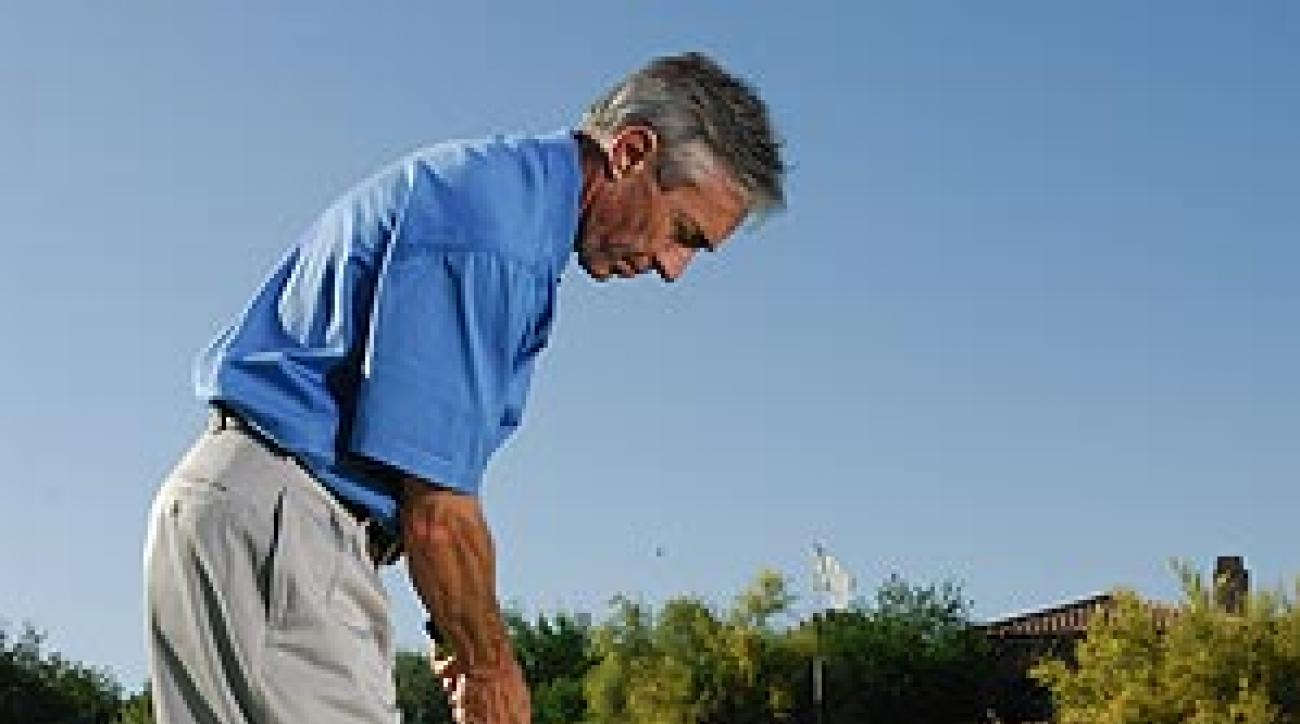 Add the pace you need to get the ball up the slope to the one needed to roll it from the edge of the slope to the hole.