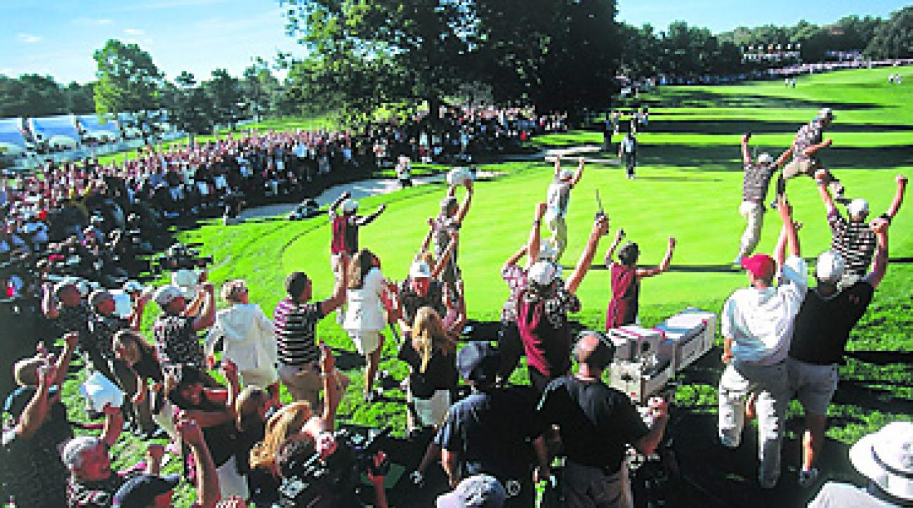 """Bertis Downs (lower left, in white shirt and blue cap) celebrated the United States' 1999 Ryder Cup win as the author (bottom center, pink shirt) looked on. <a href=""""http://i.timeinc.net/golf/i/tours/2011/09/REM-ryder-celebration-large.jpg""""><strong>Enlarge image</strong></a>"""