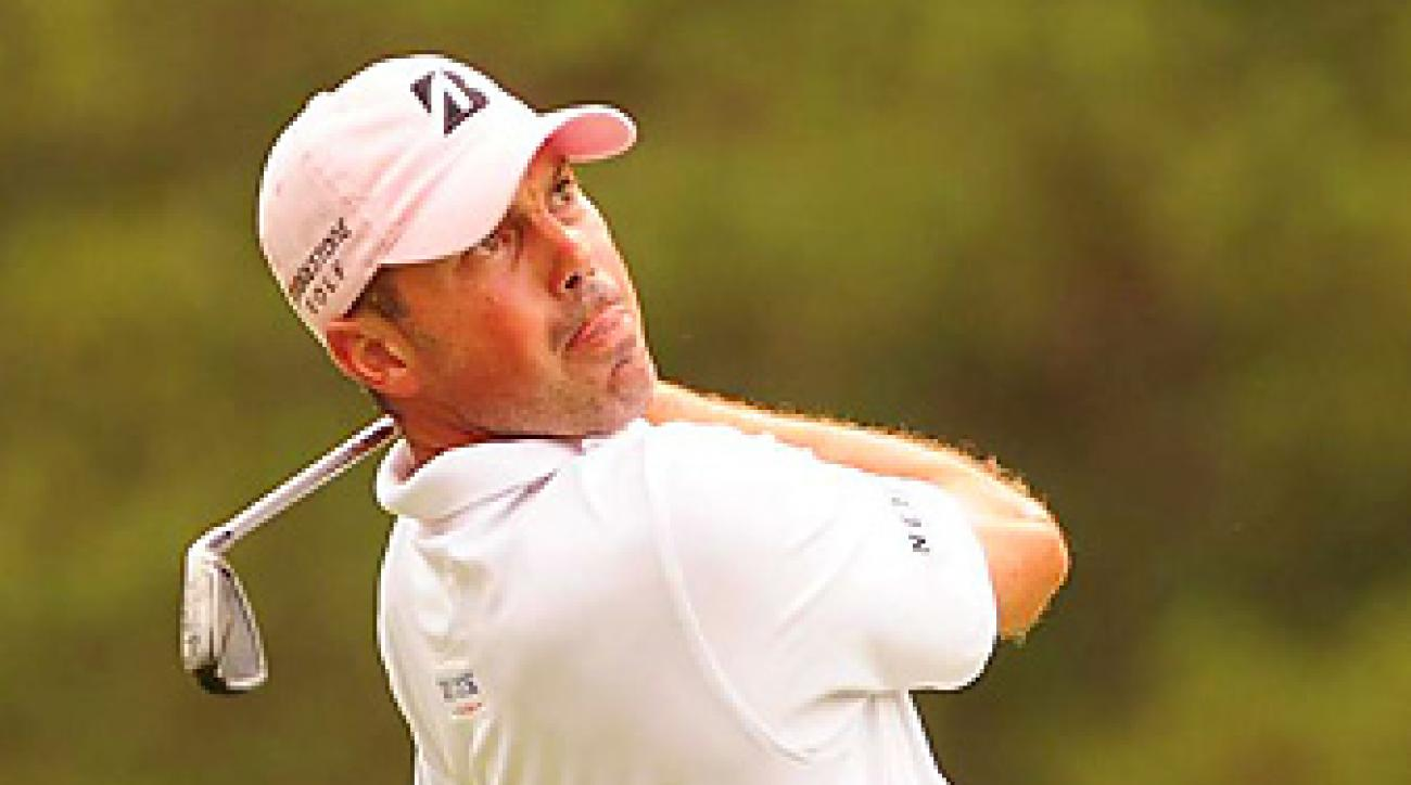 Matt Kuchar shot a 70 to win the Players by two shots.