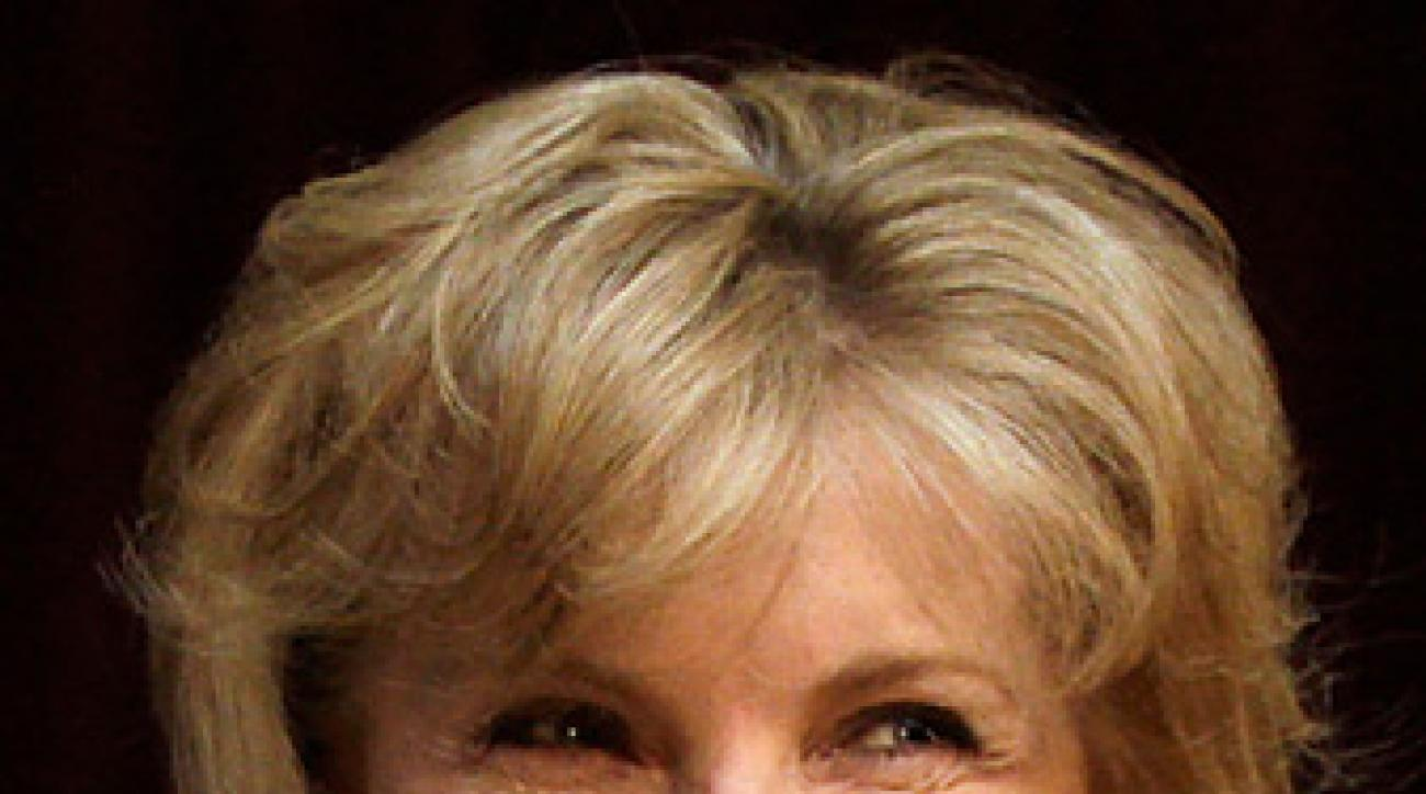 Darla Moore (pictured) and Condi Rice have been given green                 jackets, but not a chance to meet the media.