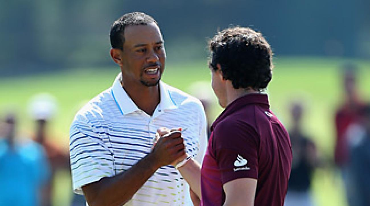 Tiger Woods shot a seven-under 64 to beat Rory McIlroy by six shots in their head-to-head match in Turkey.