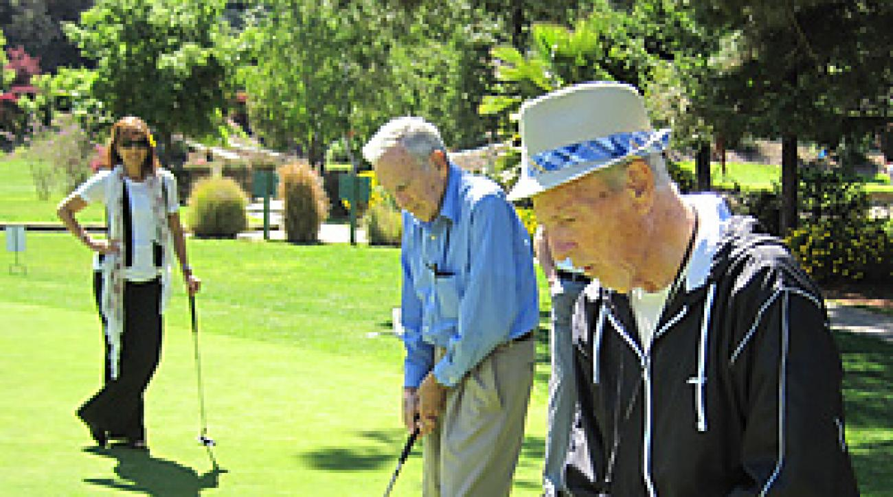 The author (background) leads an activities program at Silverado Senior Living in Belmont, Calif.