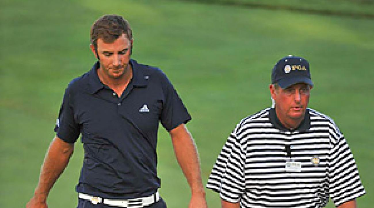 Dustin Johnson was penalized two strokes at the PGA for grounding his club in a hazard.