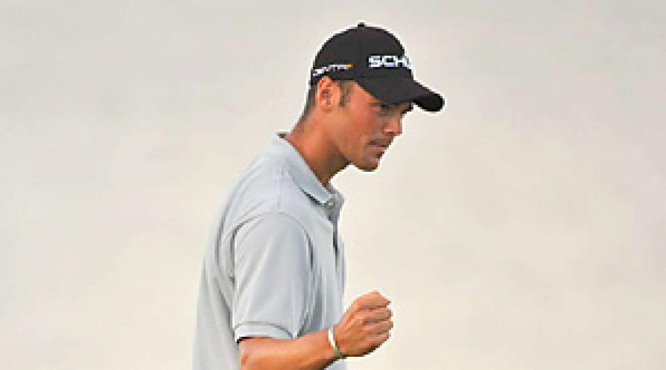 Martin Kaymer prevailed in a three-hole playoff against Bubba Watson to win his first career major title.