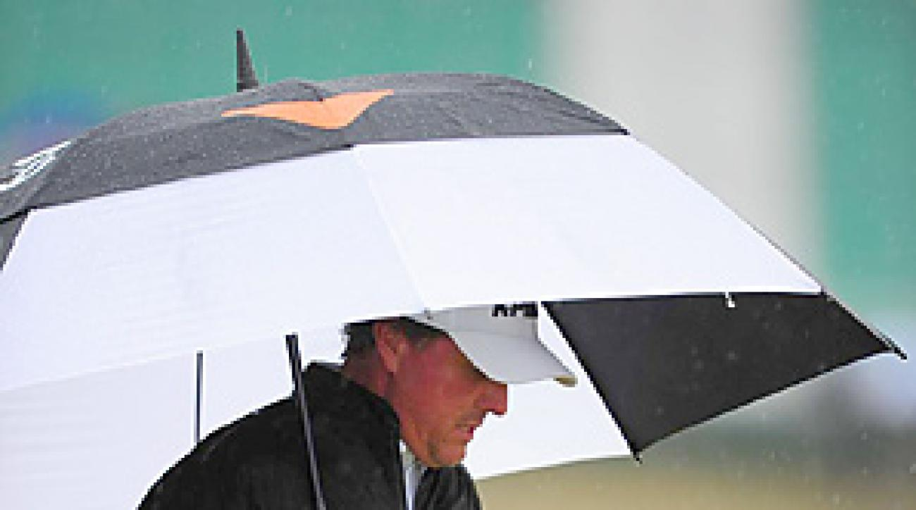 Phil Mickelson shot a 71 on a soggy Friday morning at St. Andrews.
