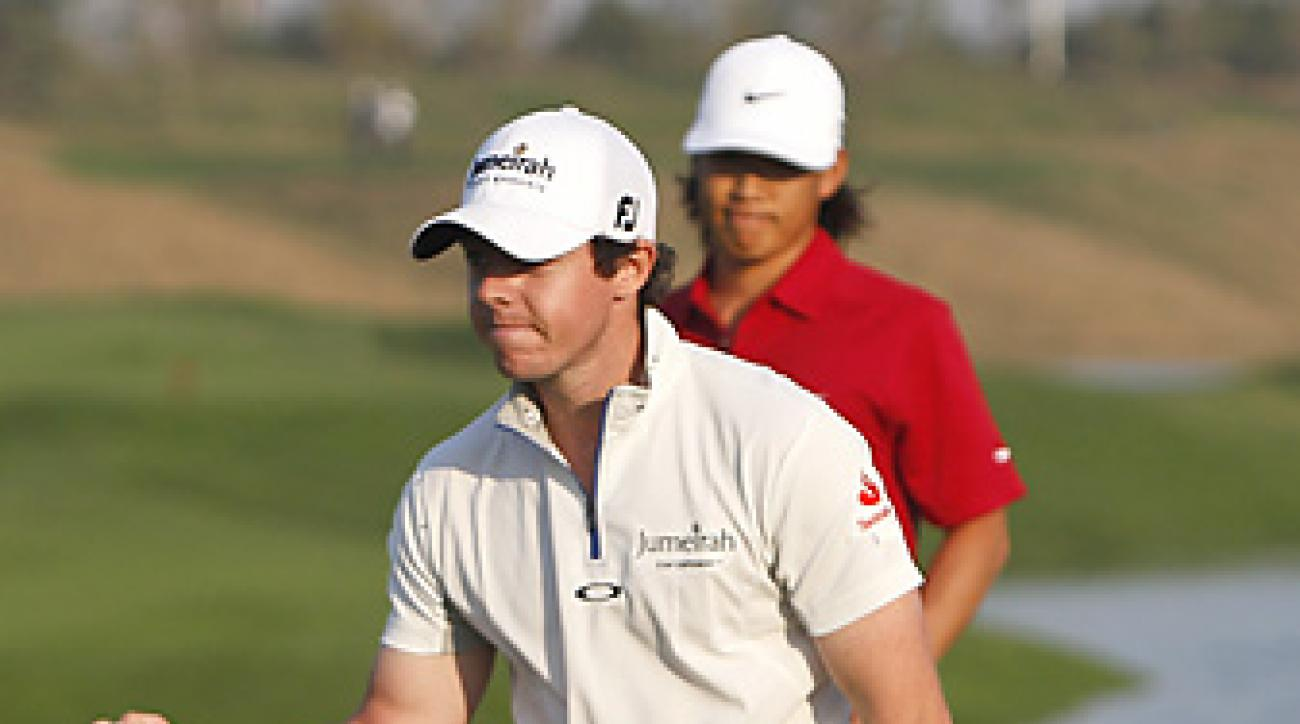 Rory McIlroy beat Anthony Kim (background) in sudden death at the Shanghai Masters.