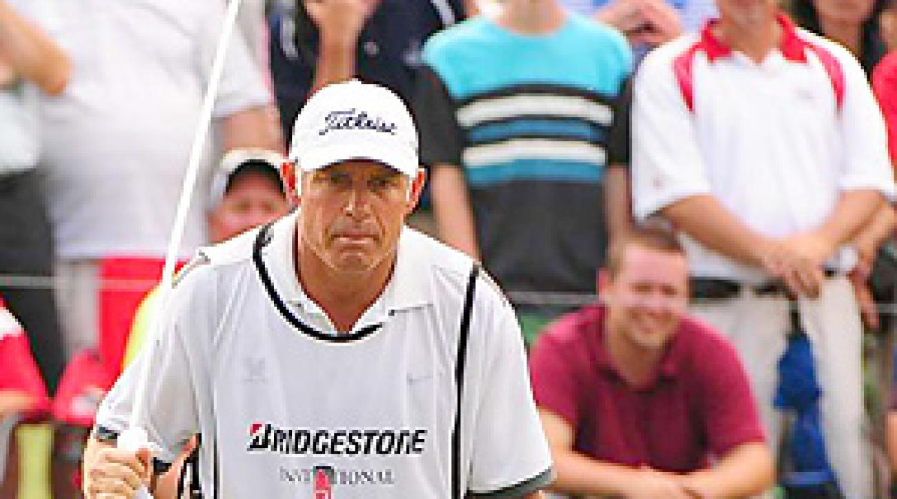 Adam Scott and Steve Williams teamed up to win by four shots at Firestone.