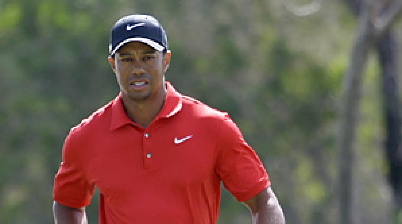 Tiger Woods was fined an undisclosed amount for spitting on a green during his final round at the Dubai Desert Classic.