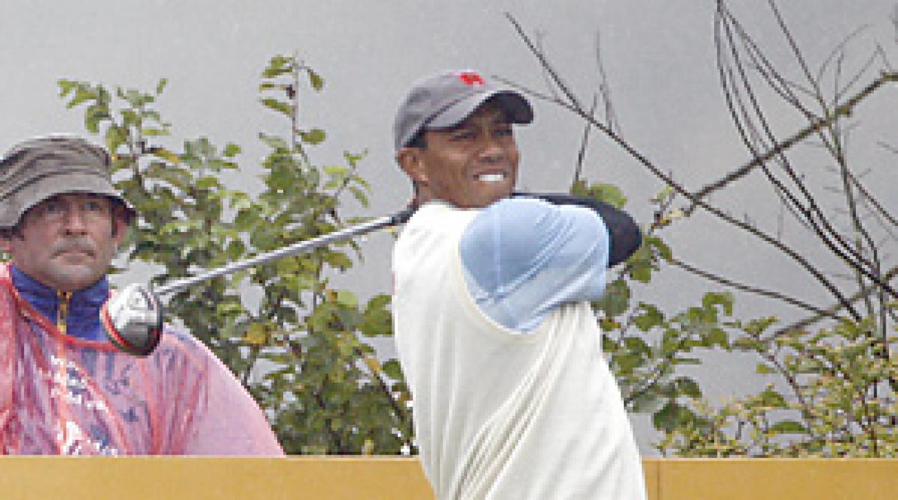 Tiger Woods and Steve Stricker are all square in their match against Ross Fisher and Ian Poulter.