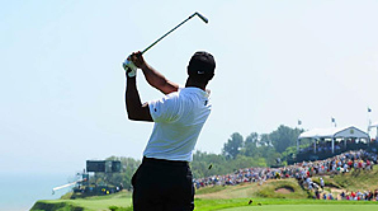 Tiger Woods showed flashes of his old form while firing an opening-round 71.