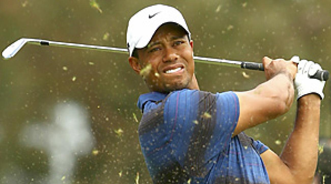 Tiger Woods is nine shots behind Adam Bland after two rounds at the Australian Masters.