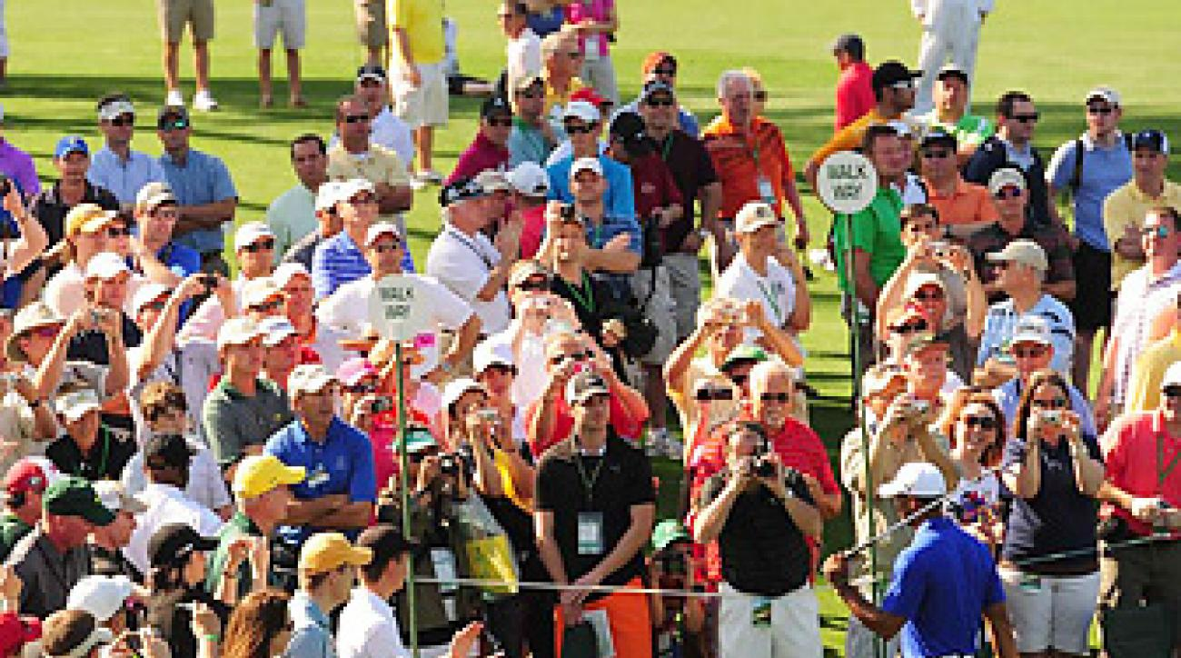 Wherever he goes at Augusta National, Tiger Woods draws a crowd.