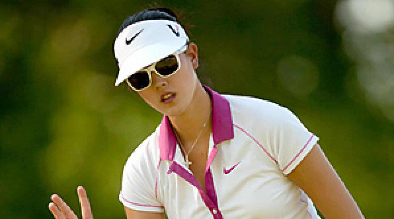 Michelle Wie shot a 7-under 65 en route to a three-shot lead after the first round.