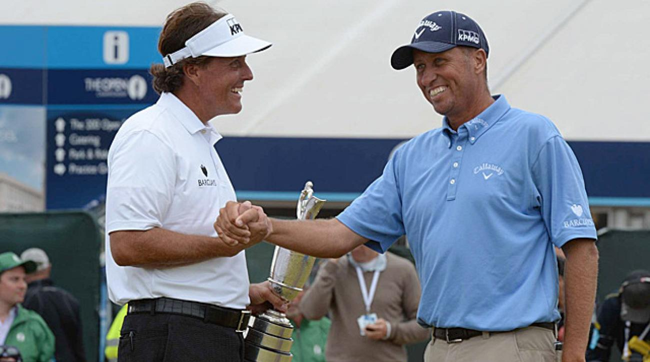 "Mickelson celebrates his victory with longtime caddie and friend Jim ""Bones"" Mackay."