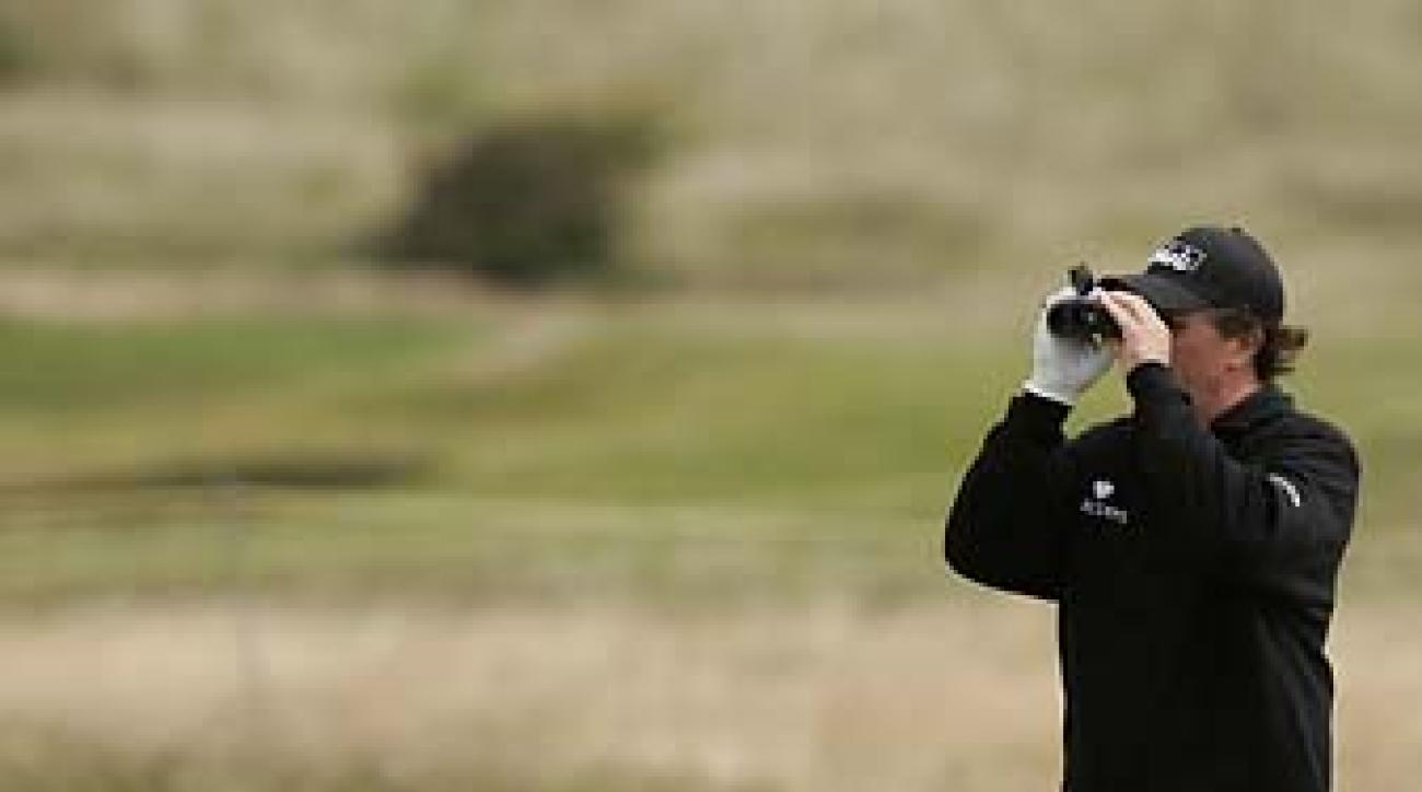 Phil Mickelson uses a rangefinder during a practice round at the 2008 British Open at Royal Birkdale.