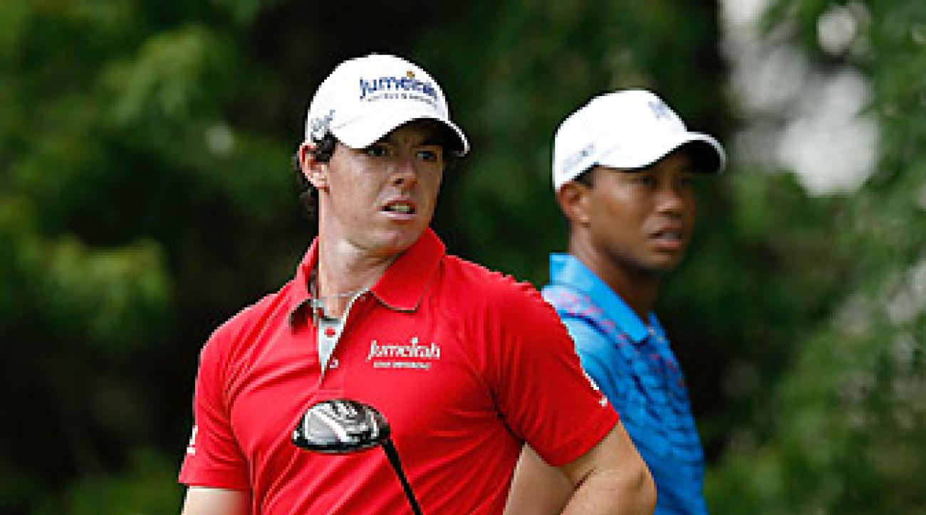 McIlroy topped Woods by one shot with a 64.