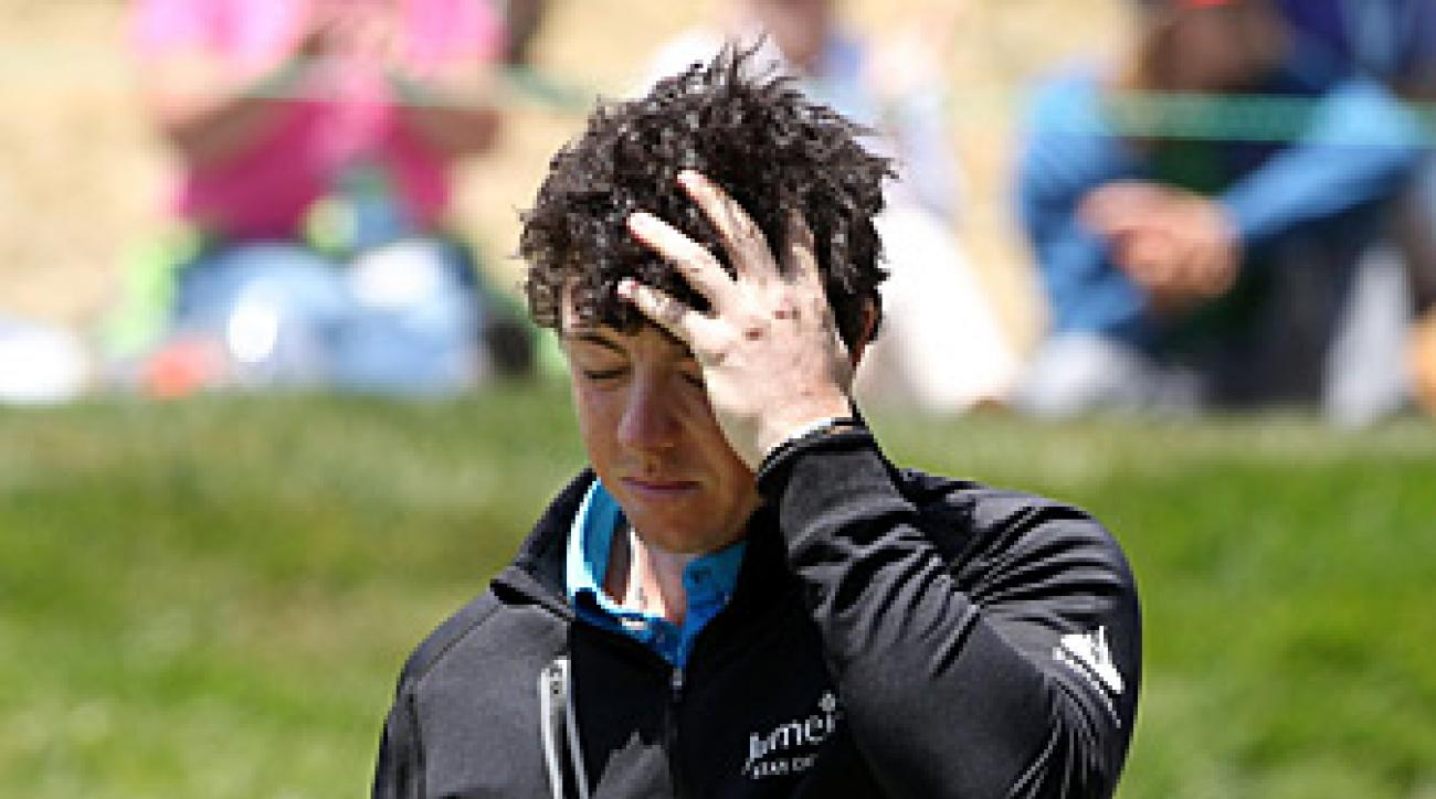 Rory McIlroy missed the cut after rounds of 77-73.
