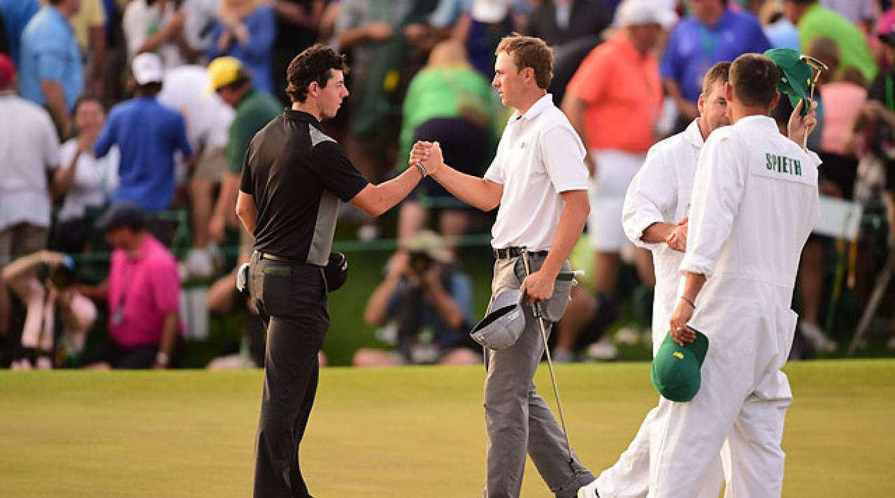 Rory McIlroy and Jordan Spieth shakes hands on the 18th green of Augusta National after the second round of the 2014 Masters.