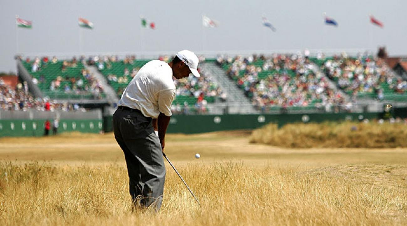 Tiger Woods hits his approach shot on the 18th hole at Royal Liverpool during the second round of 2006 Open Championship.