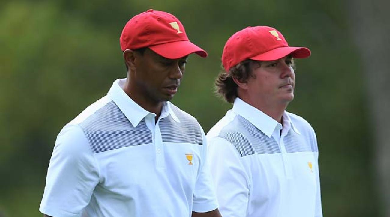 Tiger Woods and Jason Dufner play a practice round together Tuesday at the Presidents Cup in Dublin, Ohio.